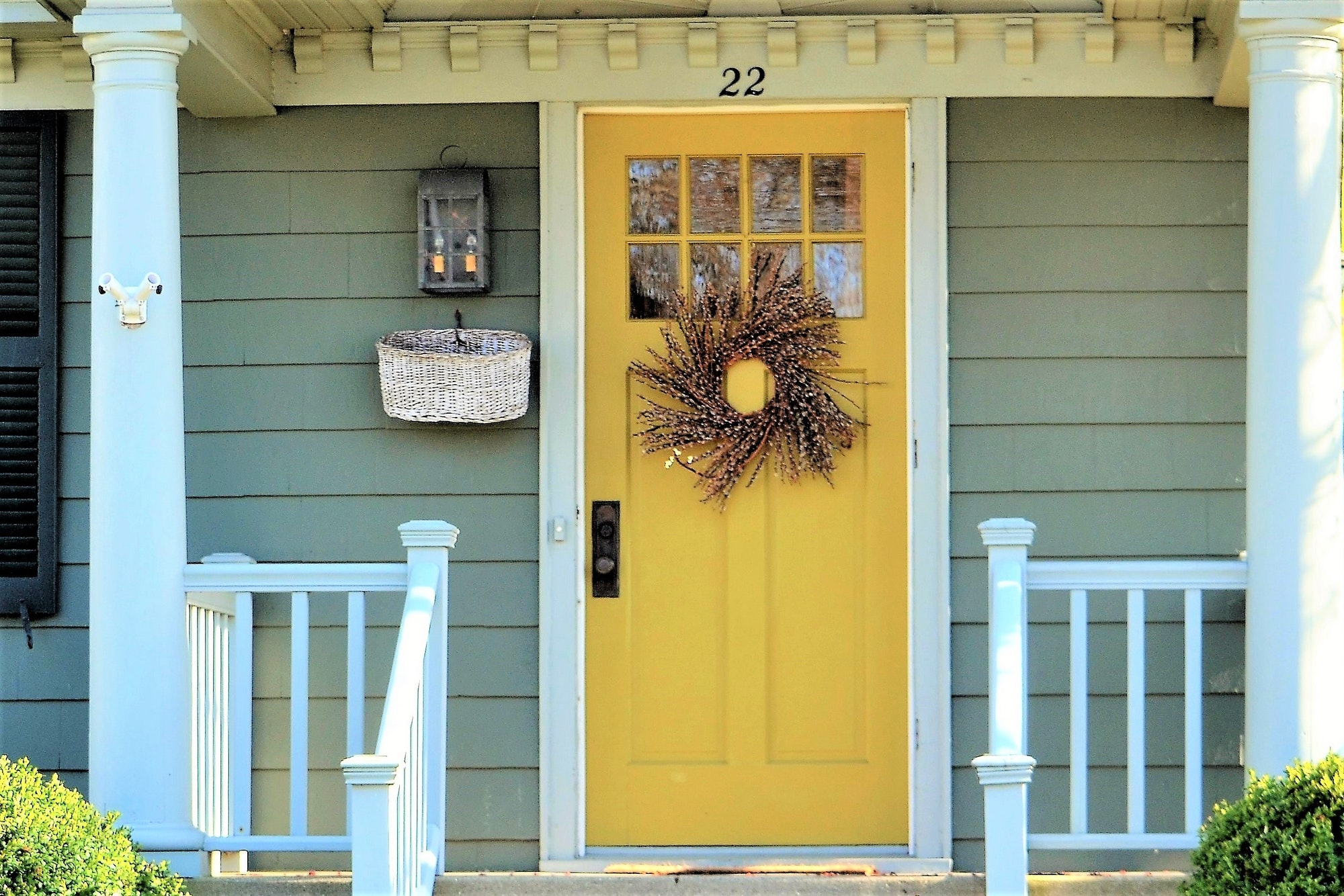 welcoming Front door entrance painted a bright yellow